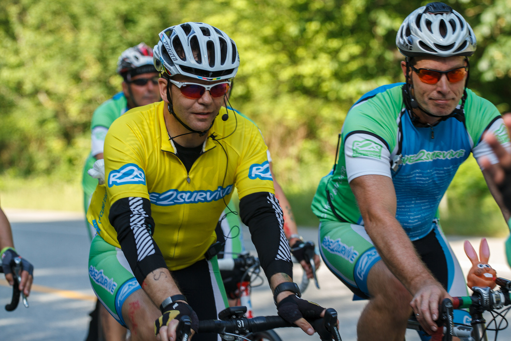 Kerry Kunzli, right, with cancer survivor Dennis Asbury, ride to raise funds for cancer research.